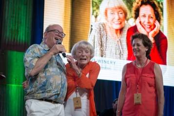 Margrit Mondavi and Geneviève Janssens go on stage with Fritz Hatton to promote their lot.