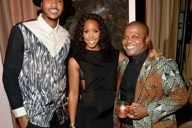 Carmelo Anthony, singer Kelly Rowland, and artist Kehinde Wiley at Carmelo Anthony Kehinde Wiley Dinner Hosted by GREY GOOSE