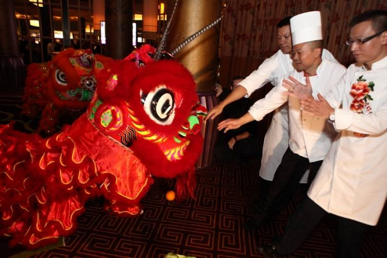 Chef Tony Hu enjoys welcoming chinese lion dance