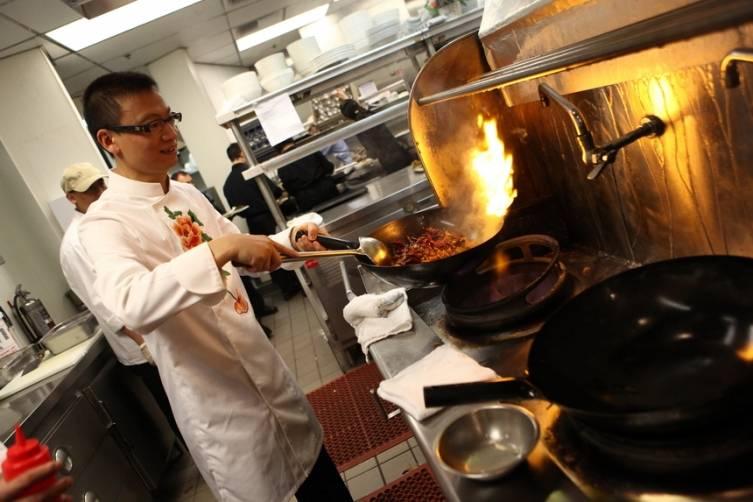 Chef Tony Hu in kitchen