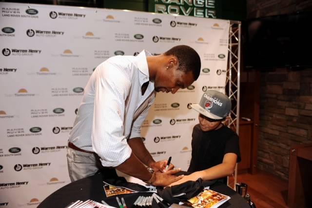 Chris Bosh autographing memorabilia