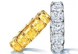 Cushion-cut fancy yellow and white diamond ring set in platinum, $250,000