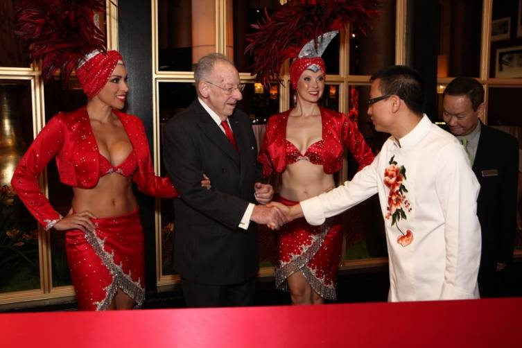Oscar Goodman and Chef Tony Hu greeting each other