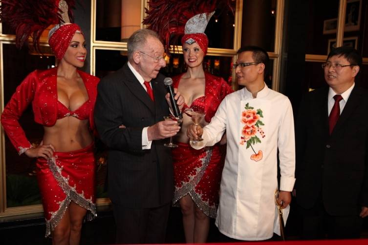 Oscar Goodman and Chef Tony Hu toast with Saphire Bombay Gin cocktail garnished with a szechuan pepper