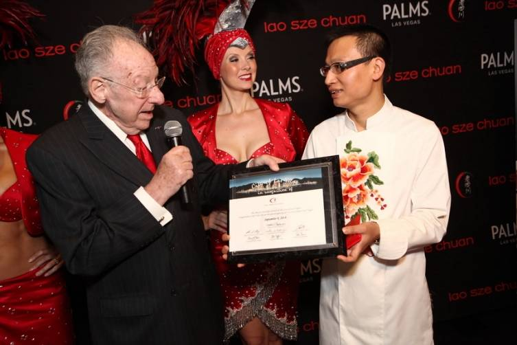 Oscar Goodman presents Chef Tony Hu with certificate of recognition