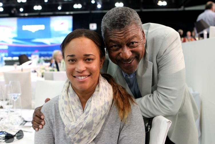 BET founder Robert Johnson poses with daughter Paige Johnson