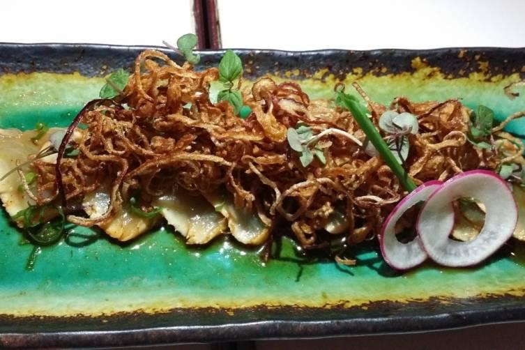 Whitefish sashimi with crispy onions