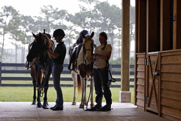 Saddling up in the stables at Pine Creek