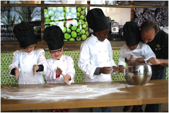 CPK Senior Vice President of Culinary Innovation Brian Sullivan teaches Las Vegas kids, members of Make-A-Wish Foundation of Southern Nevada, the art of kneading dough and the delicate touch it takes to make the perfect CPK pizza crust.