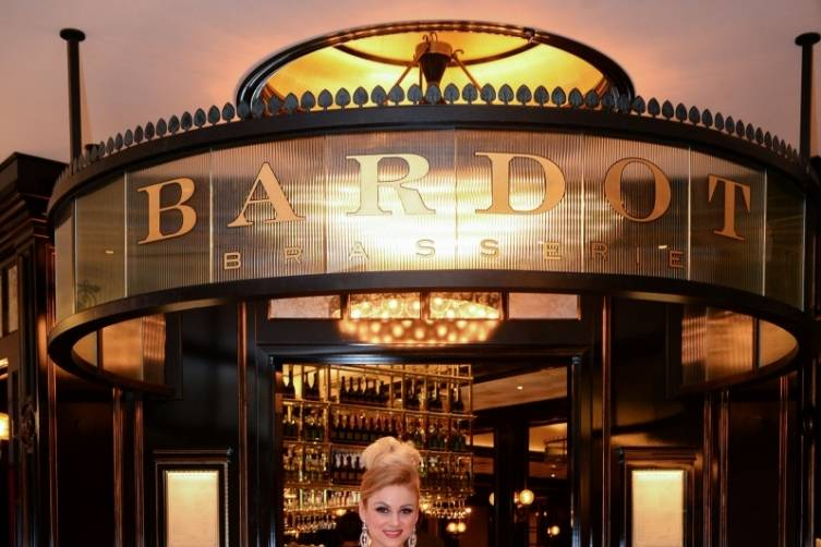 A Parisian model created the red carpet at BARDOT's Opening Party