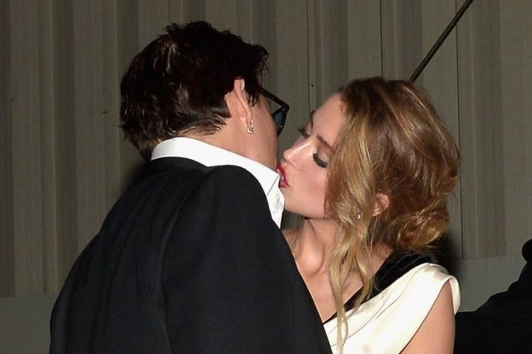 Johnny Depp kisses Amber Heard at the Art of Elysium Heaven Gala