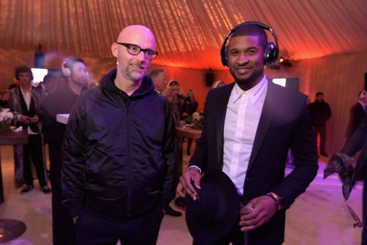 Moby and Usher wearing Samsung headphones  at the Art of Elysium Heaven Gala