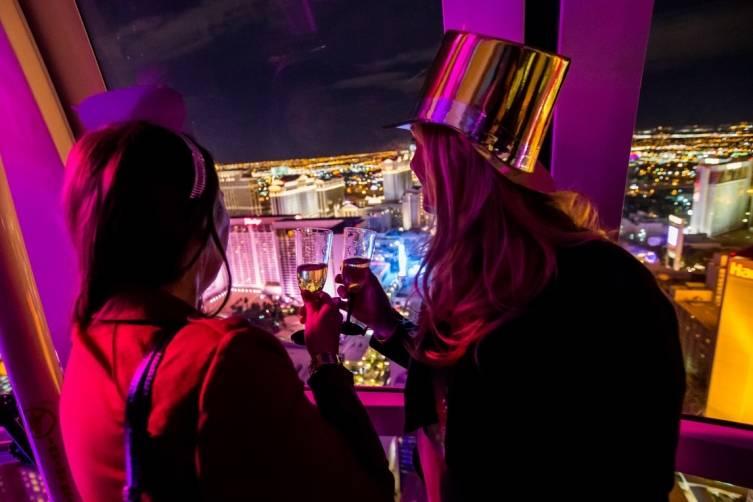High Roller passengers admire the Vegas Skyline during New Year's Eve 2015. CREDIT: ERIK KABIK / KABIK PHOTO GROUP