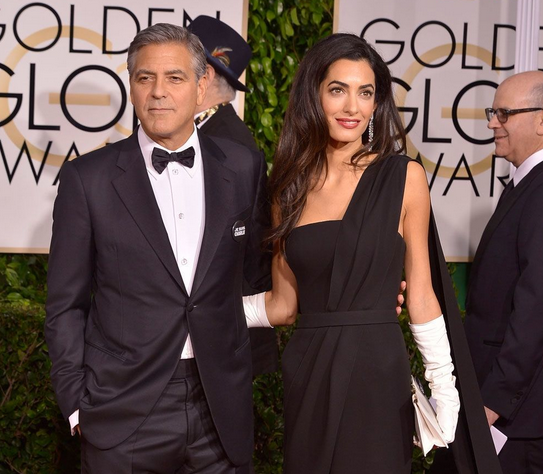 George (in Armani) and Amal (in Dior) Clooney at the 2015 Golden Globes.