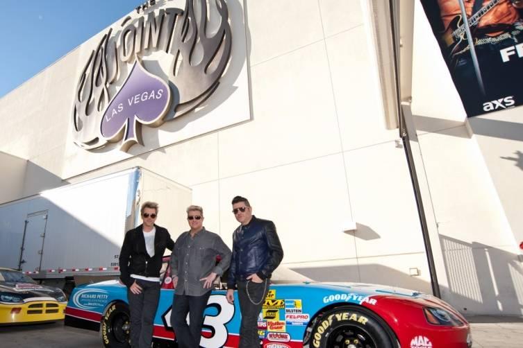 02.25.15_Rascal Flatts Pose with Richard Petty Driving Experience Race Car_Patrick Gray, Erik Kabik Photography (3)