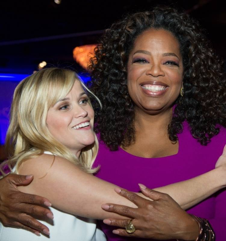 Reese Witherspoon and Oprah Winfrey hug it out