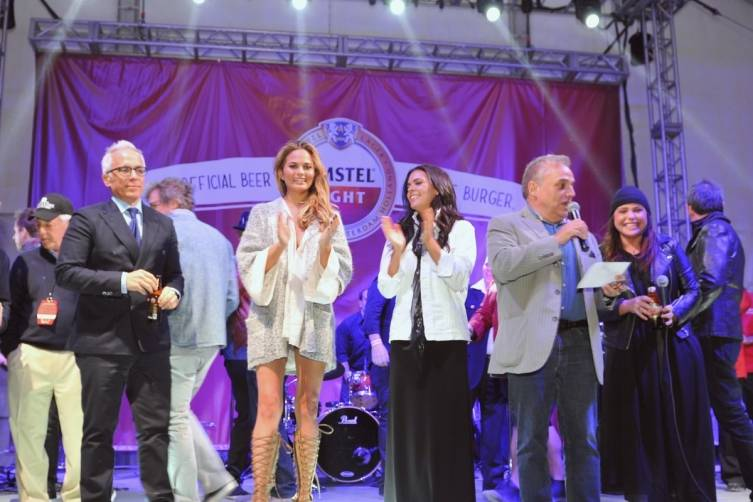Rachael Ray and Lee Brian Schrager on stage at the Burger Bash