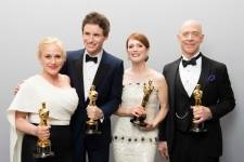 """Patricia Arquette, Oscar® Winner for Best Actress in a Supporting Role for work on """"Boyhood"""", Eddie Redmayne, Oscar® Winner for Best Actor in a Leading Role for work on """"The Theory of Everything"""", Julianne Moore, Oscar® Winner for Best Actress in a Leading Role for work on """"Still Alice"""" and J.K. Simmons, Oscar® Winner for Best Actor in a Supporting Role for work on """"Whiplash"""" pose backstage during the live ABC Telecast of The 87th Oscars® at the Dolby® Theatre in Hollywood, CA on Sunday, February 22, 2015."""