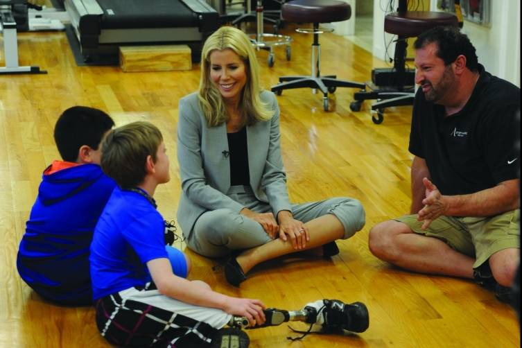 AviviaErik Schaffer and kids at A Step Ahead Prosthetics