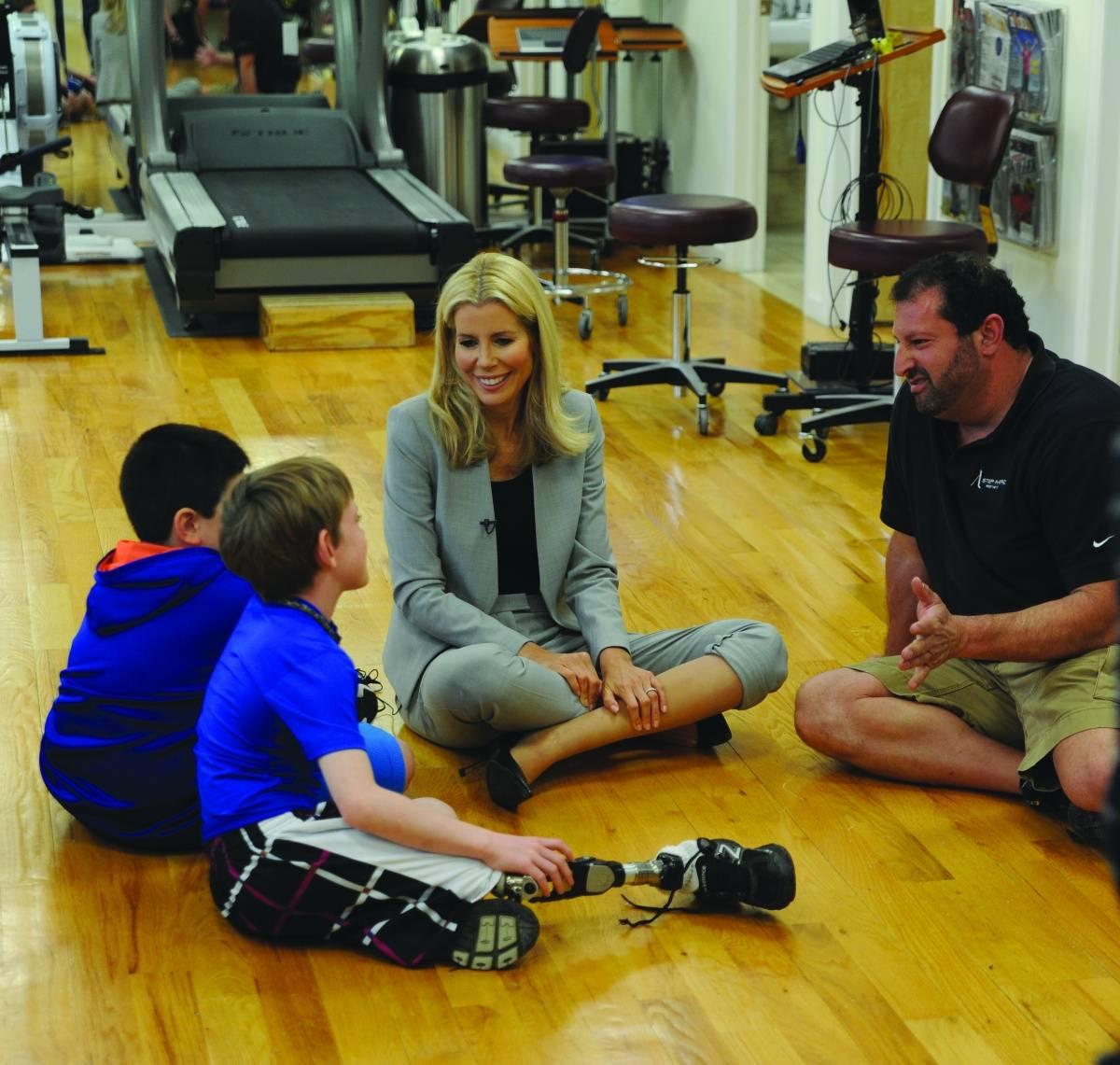 AviviaErik Schaffer and kids at A Step Ahead Prosthetics