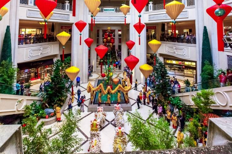 Chinese New Year Lion and Dragon Dance performers in the Waterfall Atrium at The Palazzo