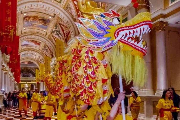 Chinese New Year Lion and Dragon Dance winds through the Grand Colonnade at The Venetian