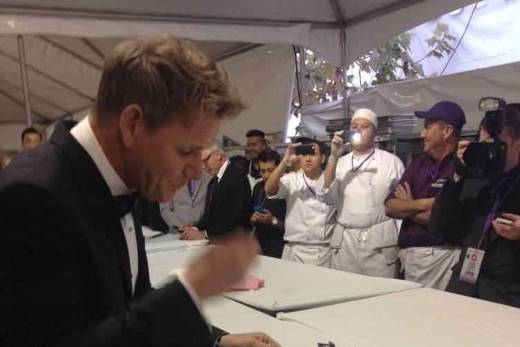 Gordon Ramsay tastes dishes at Elton John's Oscars Viewing Party.