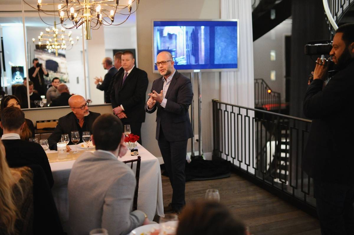 Historian and Global Brand Ambassador at Audemars Piguet Michael L. Friedman (C) speaks during Haute Time collectors dinner