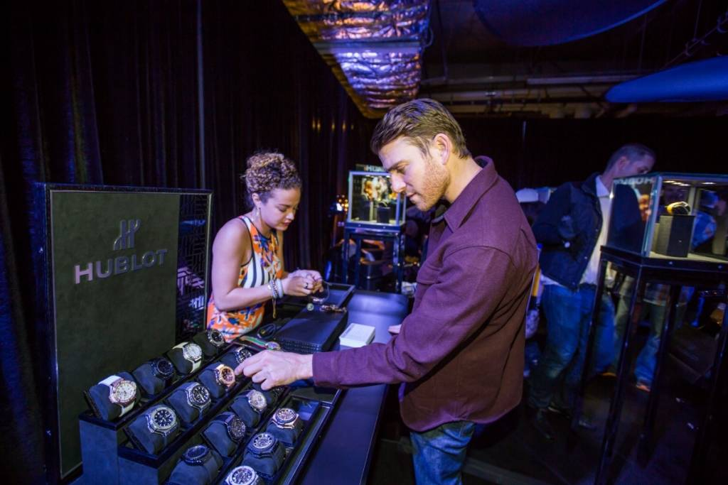 Bryan Greenberg trying on Hublot timepieces at the Hublot Shopping Event benefiting Lakers Youth Foundation