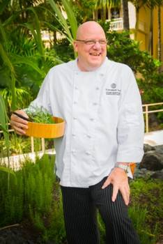Chef John Sexton in the herb garden