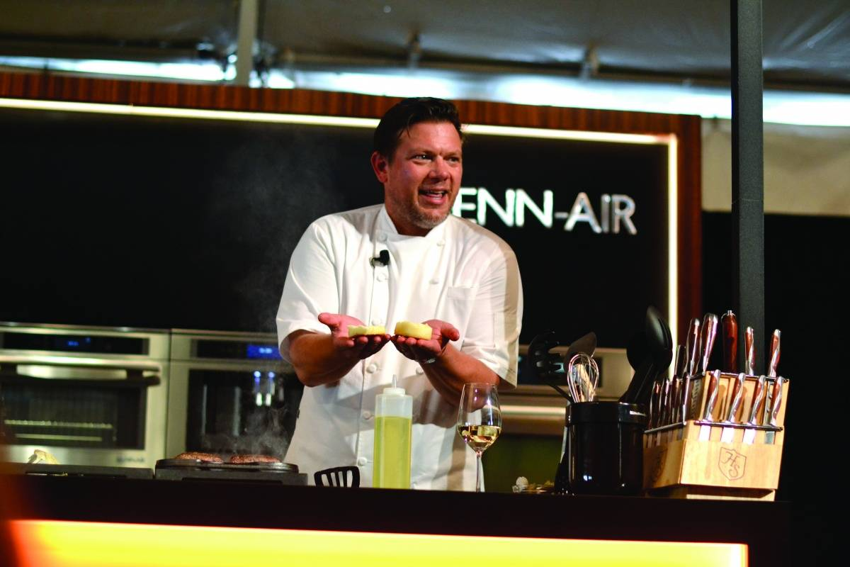 Chef Tyler Florence performing a cooking demonstration