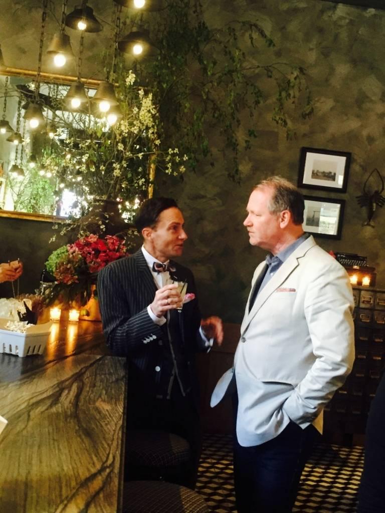 Ken Fulk mingles with a guest.