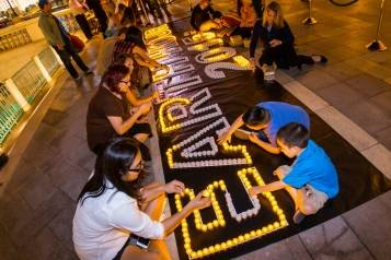 Guests and team members help with the Earth Hour display at The Venetian