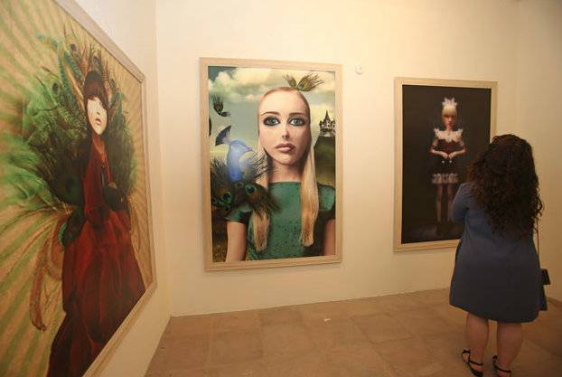 A SIKKA Art Fair patron pauses to enjoy the beauty of the work around her.