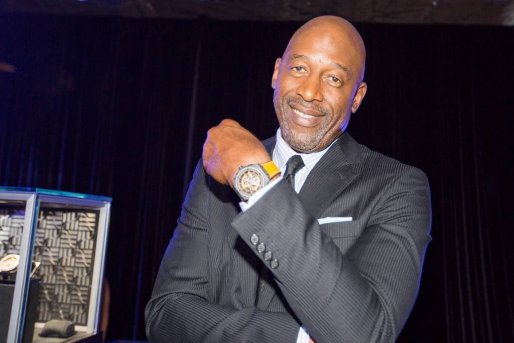James Worthy showing off The King Power Los Angeles Lakers limited edition timepiece at the Hublot Shopping Event benefiting Lakers Youth Foundation