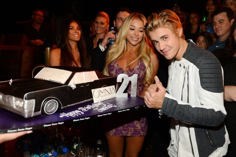 Justin Bieber with his birthday cake.