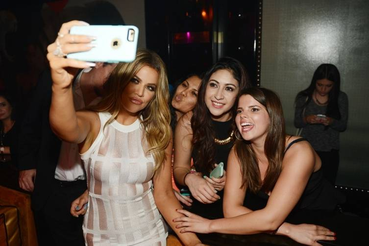 Khloe taking selfies with fans