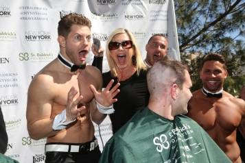 Olivia Newton-John jokes with Chippendale Jaymes Vaughn at St. Baldrick's Day at New York-New York