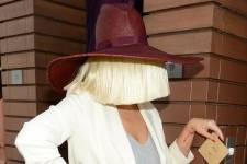 Sia wears Whole World Water bracelet at Marquee Dayclub