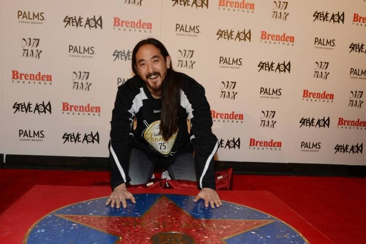 Steve Aioki poses with Brenden celebrity star at Palms Casino Resort