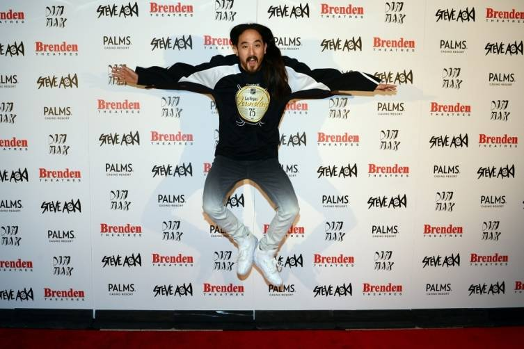 Steve Aoki jumps up in the air with excitement while being presented with Brenden celebrity star at the Palms.