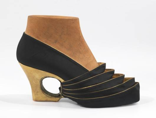 Steven Arpad, shoe prototype (evening pump), 1939. Black silk satin, gold metallic kidskin, and wood. Brooklyn Museum Costume Collection at The Metropolitan Museum of Art, Gift of the Brooklyn Museum, 2009