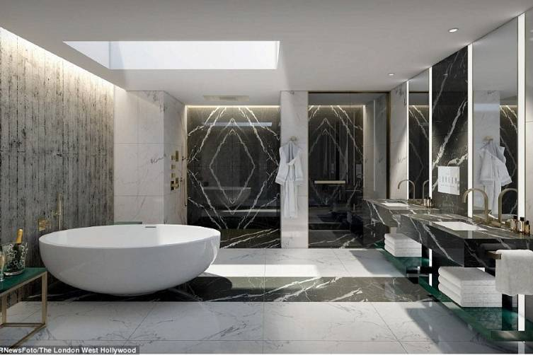 2752FCEB00000578-3027319-Wouldn_t_say_no_The_luxurious_bathroom_from_the_designer_hotel_s-a-1_1428407157457