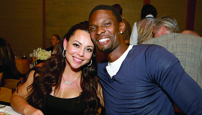 MALIBU, CA - AUGUST 07:  Miami Heat basketball player Chris Bosh (R) and Adrienne Bosh attend Haute Living celebrates the opening of Westime Malibu at Nobu Malibu on August 7, 2014 in Malibu, California.  (Photo by Rachel Murray/Getty Images for Haute Living Magazine)