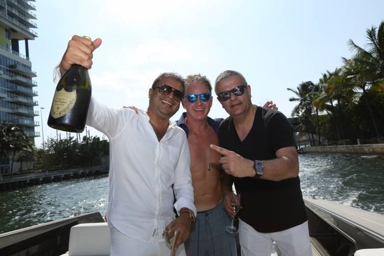 Kamal Hotchandani, Chris Hodgson, and Ricardo Guadalupe enjoy some Dom Perignon