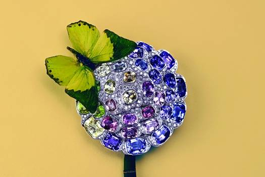 CHANEL FINE JEWELRY Camelia Exotique brooch in  white gold, white diamonds,  multicolored sapphires.