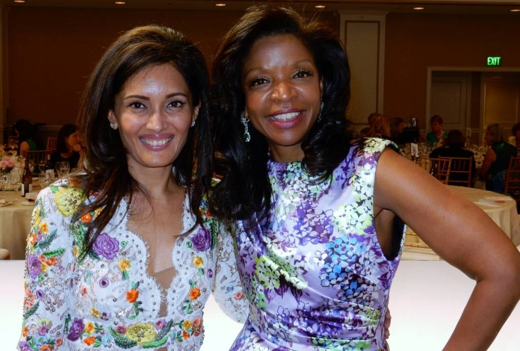 Komal Shah (in Emilio Pucci) and Pamela Joyner (in Andrew Gn)