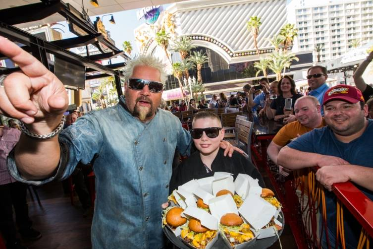 Guy Fieri and a young culinary protégé celebrate the one year anniversary of Guy Fieri's Vegas Kitchen & Bar at The Linq.