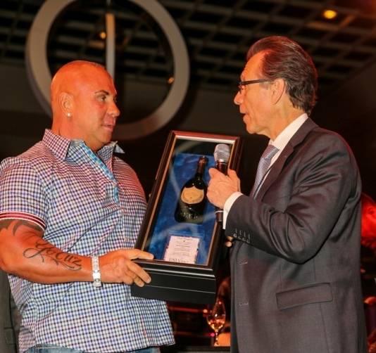 Steve Martorano accepts his Dom Perignon Award of Excellence from Michael Severino at UNLVino's Grand Tasting, 4.18.15