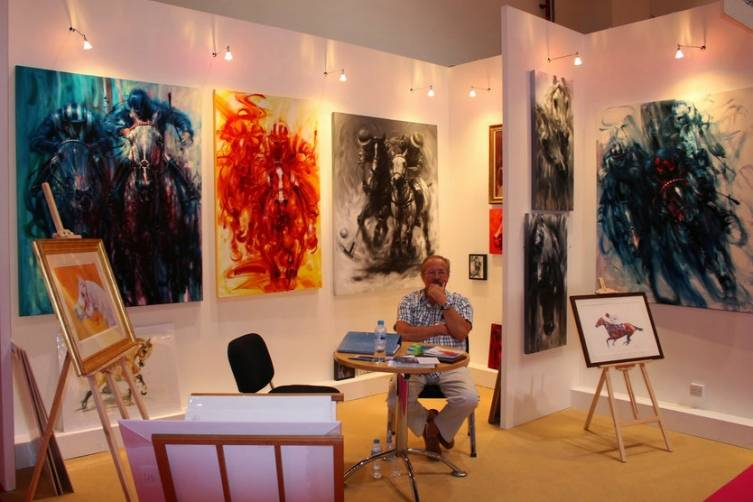 An artist and his creations at the World Art Dubai Event.